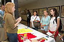 Tara Higgins, left, class of 2016, Gwendolyn Warren, Laura Leonard, Amy Schumer. Marathon group table. Student Interest Group fair.