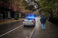 "A police car parked on Bleecker Street in the Greenwich Village neighborhood of New York on Monday, October 29, 2012 encourages residents to evacuate. Hurricane Sandy continues its steady advance with heavy wind and rain. New York has shut down the schools, the transit system and the Holland and Hugh L. Carey Tunnels have been closed. Evacuations have been ordered in the ""Zone A"" areas including Battery Park City. (© Richard B. Levine)"