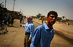 Iraqi policemen man a check point in central Ramadi on Wednesday May 23, 2007.