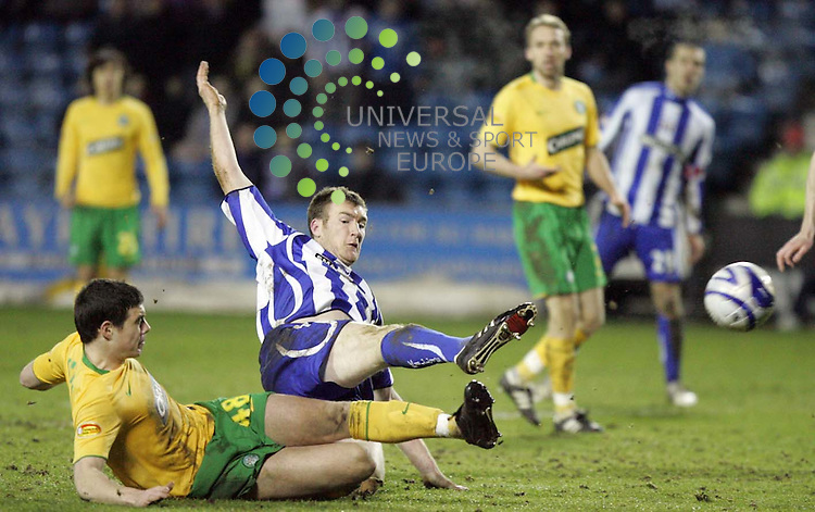 Kevin Kyle having a shot lying down as Darren O'Dea puts in a block Picture: Universal News and Sport 3/3/09. All pictures must be credited to  www.universalnewsandsport.com.(0ffice) 0844 884 51 22