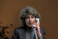 communicate, communication, talk, talking, Female office worker on telephone with cllient associate