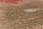 Aerial - Dam in the Strzelecki Desert for cattle just out of Birdsville belonging to Pandie Pandie Station. In dry times, these dams serve as watering holes for cattle. Dam water comes from bore water from the Great Artesian Basin