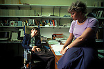 Professor Stephen Hawking Cambridege University in his office with his secretary Judy Fella. Cambridge UK 1981.