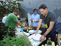 NWA Democrat-Gazette/ANDY SHUPE<br /> Jerrmy Gawthrop (right), chef and businessman from Fayetteville, sorts through ingredients Saturday, Aug. 29, 2015, during a chef's competition during the annual Roots Festival on the downtown square in Fayetteville. Gawthrop is a co-owner of Greenhouse Grille, Cardamom &amp; Curry and Woodstone Pizza.