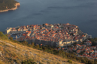 The medieval walled city, with the defensive walls and the Minceta Tower, and the old harbour on the left, Dubrovnik, Croatia, and the island of Lokrum in the top corner. The city developed as an important port in the 15th and 16th centuries and has had a multicultural history, allied to the Romans, Ostrogoths, Byzantines, Ancona, Hungary and the Ottomans. In 1979 the city was listed as a UNESCO World Heritage Site. Picture by Manuel Cohen