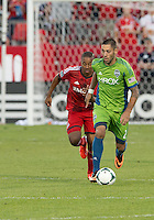 August 10, 2013: Seattle Sounders FC forward Clint Dempsey #2 and Toronto FC midfielder Reggie Lambe #19 in action during an MLS regular season game between the Seattle Sounders and Toronto FC at BMO Field in Toronto, Ontario Canada.<br /> Seattle Sounders FC won 2-1.
