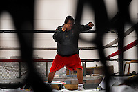 A Peruvian youth practices shadowboxing in the ring at the Boxeo VMT boxing club in an outdoor gym in Lima, Peru, 3 July 2013. Boxeo VMT is a grassroots organisation offering boxing lessons to youth as an alternative to gang violence, crime and drug-trafficking. Located in some of Lima's most marginalized neighborhoods, Boxeo VMT club joins nearly 50 young men. Although the club disposes only of an unequipped outdoor facility with couple of punching bags, the young boxers train hard three times a week and dream to become a boxing champion.
