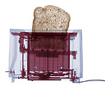 X-ray image of a toaster with bread (color on white) by Jim Wehtje, specialist in x-ray art and design images.
