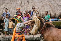 A Pasola warrior ties headress to the Nyale Pasola horse. Nyale horse plays an important role in Pasola. Considered sacred, the event cannot be started without the entrance of Nyale horse into the arena. Pasola is an ancient tradition from the Indonesian island of Sumba. Categorized as both extreme traditional sport and ritual, Pasola is an annual mock horse warfare performed in response to the harvesting season. In the battelfield, the Pasola warriors use blunt spears as their weapon. However, fatal accident still do occurs.