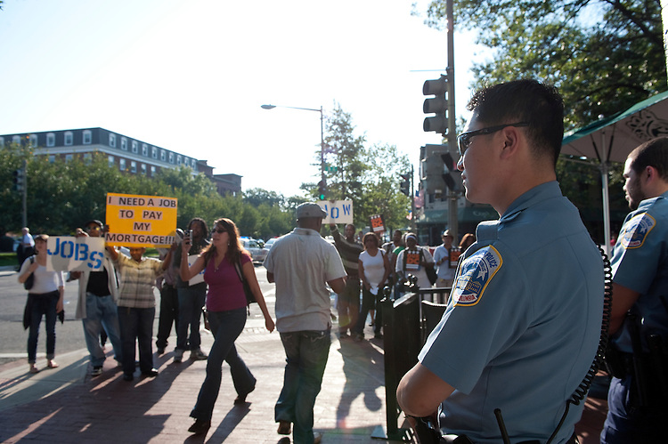 """UNITED STATES - September 13: MPD and Capitol Hill Police where called to Penn. Ave and 3rd street around 8:30 this morning for protesters from OurDC in front of the Starbucks. The protesters where asking to speak with Eric Cantor, R-VA., about the lack of jobs. Cantor who was attending a breakfast above the Starbucks was whisked away by security and never addressed the protesters. Starbucks had a """"We Are Hiring"""" sign in the window. (Photo By Douglas Graham/Roll Call)"""