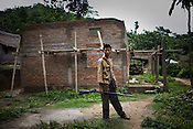 43 year old Zeme Naga, Damtuing is seen patrolling the village, he like many other Zeme Nagas have taken shelter in lower Mabauram. Suspected Dimasa group killed 2 youths (aged 16 and 14) and burnt 21 houses out of 25 in village Mabauram in the outskirts of Haflong, Assam, India. Ethnic clashes are regularly taking place between Zeme Nagas and the Dimasa tribe in North Cachar Hills.