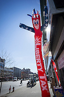 An inflatable advertises the presence of a Liberty Tax preparation store in Harlem in New York on Fruday, February 28, 2014. (© Richard B. Levine)