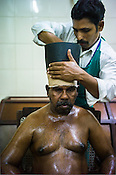 Workers prepare the resident patients for the Siro Vasti (ayurvedic oil on the head treatment) at the National Research Institute of Panchakarma in Cheruthuruthy in Thissur district of Kerala, India.