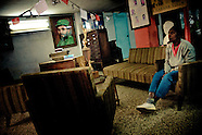 A Cuban woman waits, sitting on a sofa, in an entrance room to the Cuban state office in Havana, Cuba, 4 February 2009. During the Cuban Revolution, an armed rebellion at the end of the 1950s in Cuba, most of the revolutionary leaders started as no-name soldiers fighting in the jungle. Although the revolutionary leaders, after taking over the power, became autocratic rulers holding almost absolute power and putting the opposition in jail, for some reason Cuban people have never stopped to worship Fidel Castro, Che Guevara, Raul Castro and others. Cubans hang their photos and portraits on the wall in homes, shops and working places even they don't have to. The people of Cuba love their heroes.