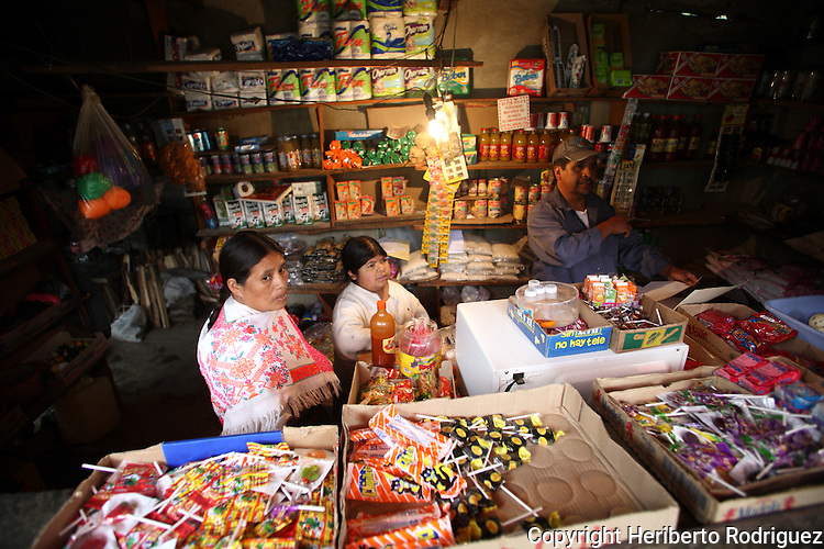 A Native Mexican woman buys fast food in a store in a Acaxochitlan village in northeastern state of Puebla, October 16, 2008. Photo by Heriberto Rodriguez