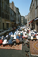 May 1989, Marseilles, France --- Muslim immigration in the port city of Marseille. Muslim men at pray on Bon Pasteur street. --- Image by © JP Laffont