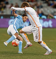 Melbourne, 21 July 2015 - Jesús Navas of Manchester City and Adem Ljajić of AS Roma fight for the ball in game two of the International Champions Cup match at the Melbourne Cricket Ground, Australia. City def Roma 5-4 in Penalties. (Photo Sydney Low / AsteriskImages.com)