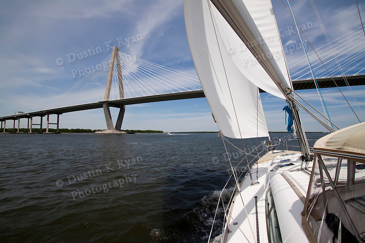 Arthur Ravenel Jr Bridge over the Cooper River, also known as the Cooper River Bridge.  Located on the harbor in Charleston South Carolina Sailboat, yacht, beneteau