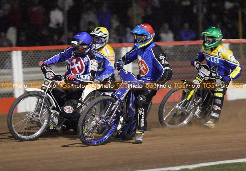 Arena Essex Hammers vs Eastbourne Eagles, Spring Cup 1st Leg - 17/03/06 - Arena's Andreas Jonsson (red) and Joonas Kylmakorpi enter the first bend ahead of David Norris (green) and Nicki Pedersen in Heat 13 - (Gavin Ellis 2006)
