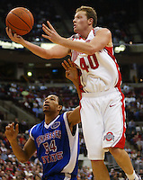 Ohio State's Matt Sylvester unsuccessfully tries for a layup over Tennessee State's Clarence Matthews during their game at Value City Arena on December 23, 2005. (Dispatch Photo by Pete Kiehart)