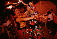 Zapotec Indian women in traditional clothing dance into the night at a wedding party in the street. Weekends are full of wedding celebrations in the Isthmus of Tehuantepec in Mexico, the narrow and flat part of the country where the Zapotec culture is still strong. <br />