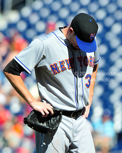 New York Mets pitcher Bobby Parnell bows his head between pitches in the ninth inning against the Washington Nationals at Nationals Park in Washington, D.C. on Sunday, July 31, 2011.  The Nationals won the game 3 - 2..Credit: Ron Sachs / CNP.(RESTRICTION: NO New York or New Jersey Newspapers or newspapers within a 75 mile radius of New York City)