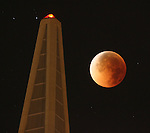 The moon turned a yellowish brown to a blood red during Tuesday night's total lunar eclipse as it passed by the TransAmerican Pyramid in San Francisco. The moon's surface darken as the earth's shadow creeped across it to create a partial eclipse from just before 1:51am (PST) with the total eclipse visible one hour later...8/28/07. {Photographed by Frederic Larson}