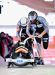 18 December 2010: Karl Angerer starts up his 2-man bobsled for Germany, winning bronze at the Viessmann FIBT World Cup Bobsled Championships on Mount Van Hoevenberg in Lake Placid, New York, USA. Mandatory Credit: Ed Wolfstein Photo
