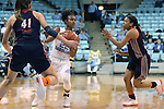 20 November 2016: North Carolina's Paris Kea (22) drives between Bucknell's Sune Swart (41) and Kyi English (right). The University of North Carolina Tar Heels hosted the Bucknell University Bisons at Carmichael Arena in Chapel Hill, North Carolina in a 2016-17 NCAA Women's Basketball game. UNC won the game 65-50.
