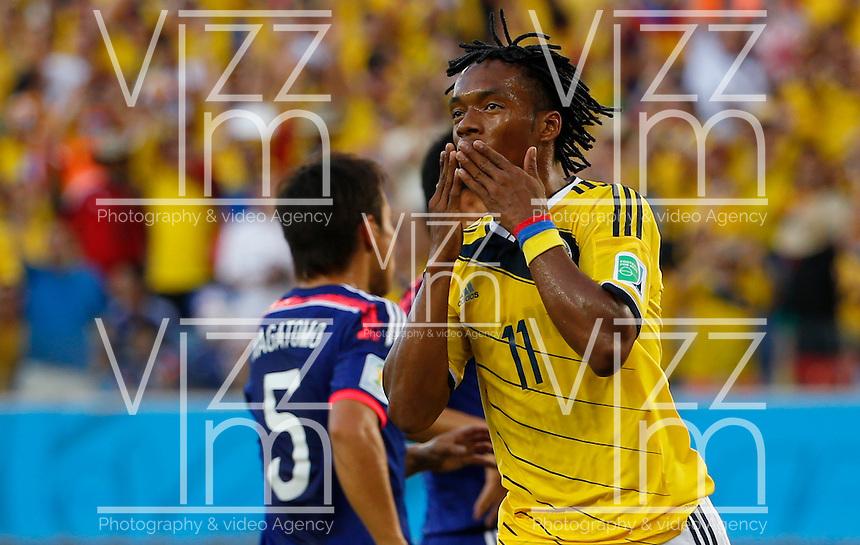 CUIABA - BRASIL -24-06-2014. Foto: Roberto Candia / Archivolatino<br /> Juan Cuadrado (#11) jugador de Colombia (COL) celebra un gol anotado a Jap&oacute;n (JPN) durante partido del Grupo C de la Copa Mundial de la FIFA Brasil 2014 jugado en el estadio Arena Pantanal de Cuiaba./ Juan Cuadrado (#11) player of Colombia (COL) celebrates a goal scored to Japan (JPN) during the macth of the Group C of the 2014 FIFA World Cup Brazil played at Arena Pantanal stadium in Cuiaba. Photo:  Roberto Candia / Archivo Latino<br /> VizzorImage PROVIDES THE ACCESS TO THIS PHOTOGRAPH ONLY AS A PRESS AND EDITORIAL SERVICE IN COLOMBIA AND NOT IS THE OWNER OF COPYRIGHT; ANOTHER USE IS REPONSABILITY OF THE END USER. NO SALES, NO MERCHANDASING. ALL COPYRIGHT IS ARCHIVOLATINO