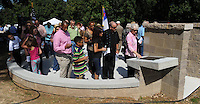 STAFF PHOTO ANDY SHUPE - Visitors file past a monument and a pair of plaques during a dedication ceremony Sunday, Sept. 21, 2014, for the Gehring Cemetery at Christian Life Cathedral in Fayetteville.