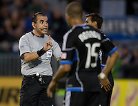 FIFA referee Baldomero Toledo talks with Earthquakes players during the game against Seattle at Buck Shaw Stadium in Santa Clara, California on August 11th, 2012.   Earthquakes defeated Sounders, 2-1.