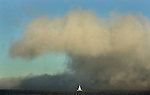 A wall of fog pushes forward as a sail boat was in the mix on San Francisco Bay.