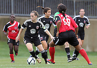 BOYDS, MARYLAND - July 21, 2012:  Mikaela Howell (8) of DC United Women moves the ball away from Victoria Johnson (26) of the Virginia Beach Piranhas during a W League Eastern Conference Championship semi final match at Maryland Soccerplex, in Boyds, Maryland on July 21. DC United Women won 3-0.