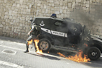 Border Patrol Officer is being hit from a Molotov cocktail being thrown at him by an arab youth, in the east Jerusalem neighborhood of Silwan. March 18, 2011.  Photo by Oren Nahshon.