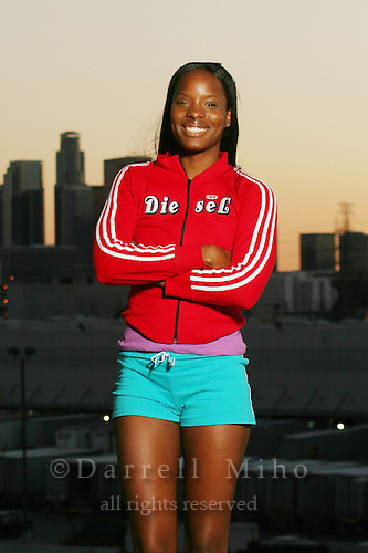 Model: LaKreshia Hart<br /> athlete, red jacket, blue shorts.  At dusk with downtown LA as a backdrop.<br /> <br /> Photo Credit Darrell Miho.<br /> &copy; Darrell Miho