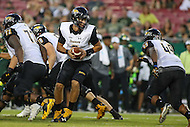 Tampa, FL - September 2, 2016: Towson Tigers quarterback Morgan Mahalak (6) looks to hand the ball off during game between Towson and USF at the Raymond James Stadium in Tampa, FL. September 2, 2016.  (Photo by Elliott Brown/Media Images International)