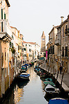 A canal in Venice Italy with gondolas.