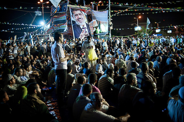 Magali Corouge . Documentography<br /> Cairo, Egypt, the 10th of July 2013.<br /> <br /> Rabaa Al Adaweya square, in Nasr City. Pro Morsi supporters have decided not to move from their sit in as long as Mohamed Morsi is being detained.<br /> <br /> MB supporters are sitting facing the Mecca before the prayer just after Iftar.