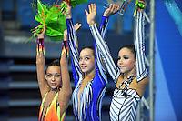 (L-R) Junior winners of team silver medal from Belarus are:  Ksenya Cheldishkina, Katia Galkina, Maria Kadobina at 2010 Pesaro World Cup on August 27, 2010 at Pesaro, Italy.  Photo by Tom Theobald.