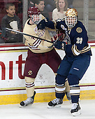 Adam Gilmour (BC - 14), Stephen Johns (ND - 28) - The visiting University of Notre Dame Fighting Irish defeated the Boston College Eagles 2-1 in overtime on Saturday, March 1, 2014, at Kelley Rink in Conte Forum in Chestnut Hill, Massachusetts.