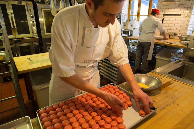 Making fresh macaroons at Le Cochon Dingue, a restaurant featuring Quebec cuisine such as sugar pie and poutine located in lower Vieux Quebec, Quebec City, Canada