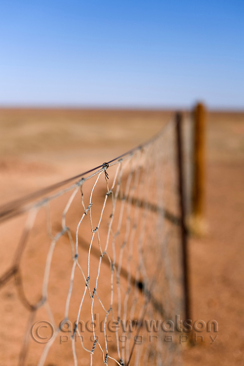 The Dog Fence - the longest continual fence in the world, stretching 5300km from Queensland to South Australia.  It was built to protect the sheep country in the south from the Dingo (native Australian dog).  Coober Pedy, South Australia, AUSTRALIA.
