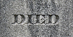 "The word ""Died"" etched on a grave stone."
