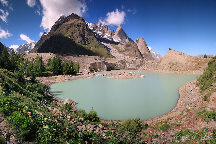 Miage is a small glacial lake placed at the feet of the Monte Bianco range, and at the lower end of the Miage glacier, one of the many huge glaciers of the massif, and the biggest one in Italian territory. I took this picture on a early summer morning from atop the morain that encircle the lake. Dome the Miage, Aguille Blanche and Noire de Peteury, and Dames Anglaises are some of the peaks lying in the background.