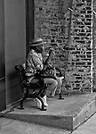 Elderly lady resting on bench in downtown Vicksburg, Mississippi