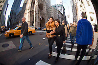 Shoppers on Fifth Avenue on Black Friday, the day after Thanksgiving, Friday, November 25, 2011 in New York.  Many retailers opened their doors on Thanksgiving or opened up for Black Friday the night before extending the shopping day into over 24 hours. (© Frances Roberts)
