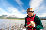 Sparks Lake is a lake in Deschutes County, Oregon. Many of Deschutes County's other natural sites can be seen from the lake, such as Mount Bachelor. There are seven mountains near the lake. Including Three Sisters, Broken Top, and Mount Jefferson.  Our tour guide, James Jaggard, paddling us around the lake in a canoe.