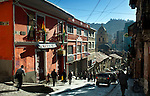 Morning rush hour on the steep slopes of Calle Sagarnaga in La Paz as Bolivians hurry toward downtown and the Iglesia San Francisco.  Many tourists visit Sagarnaga Street because of its markets and souvenir stores.