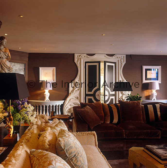 An ornate door frame is the focal point of this elegant and comfortable drawing room